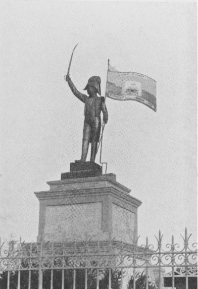 """Normil Charles, The Statue to Dessalines on the Champ de Mars, Port-au-Prince, 1904. Photograph by Sir Harry Johnston, c. 1908-09. First published in Sir Harry Johnston, The Negro in the New World (London: 1910); reprinted unattributed, Statue of Dessalines, Erected 1904 in Anonymous, """"Wards of the United States: Notes on What Our Country is Doing for Santo Domingo, Nicaragua, and Haiti,"""" National Geographic Magazine 30 (August 1916): 173. Photograph available through the New York Public Library Schomburg Center for Research in Black Culture"""